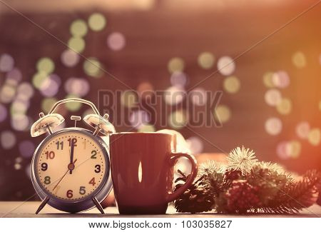 Cup Of Tea And Alarm Clock With Christmas Lights