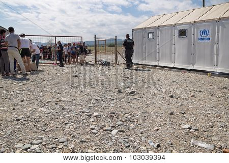 GEVGELIJA, MACEDONIA: SEPTEMBER 11, 2015: Group of  immigrants and refugees from Middle East and North Africa waiting in front of UNHCR camp.