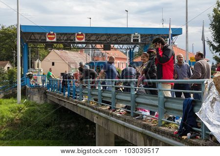 HARMICA, CROATIA: SEPTEMBER20, 2015: Group of immigrants and refugees from Middle East and North Africa at Harmica, state border between Slovenia and Croatia.