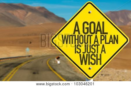 A Goal Without a Plan Is Just a Wish sign on desert road