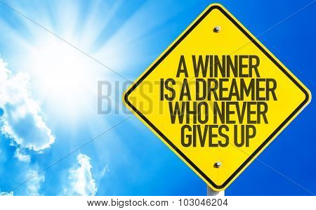 A Winner Is A Dreamer Who Never Gives Up sign with sky background