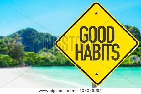 Good Habits sign with beach background