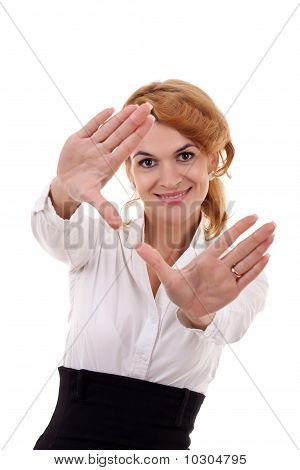 Woman Looks Through A Hand Frame