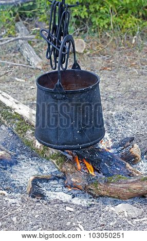 The Bucket Over The Fire
