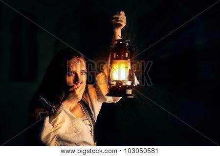 Scared Medieval Princess Holding Lantern