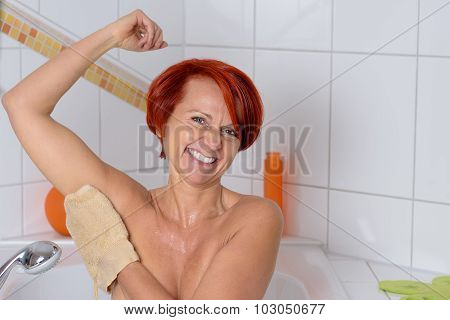 Happy Middle Aged Woman Washing Her Armpit