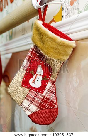 red Christmas stocking hanging on the wall