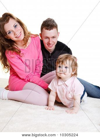 Young Parents With Baby Daughter