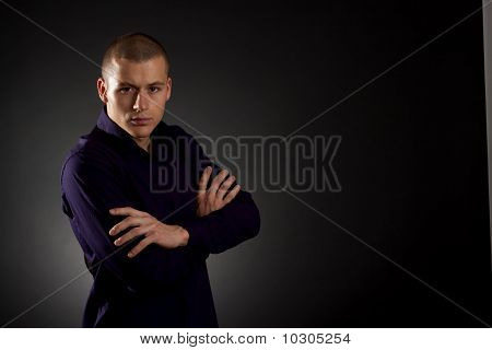 Young Man On A Dark Background