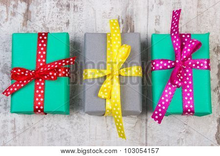 Wrapped Colorful Gifts For Christmas Or Other Celebration On Old White Plank