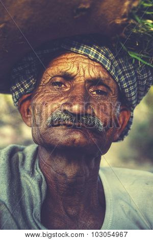Indigenous Senior Indian Man Grumpy Camera Concept