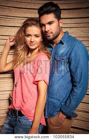 man holding his sexy blonde girlfrend while having his hand in pocket