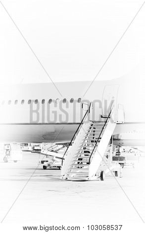 Passenger Plane In The Airport. Black And White Photo.