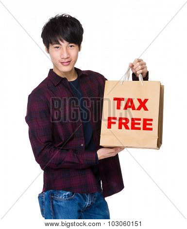 Young Man hold with shopping bag for showing phrase of tax free