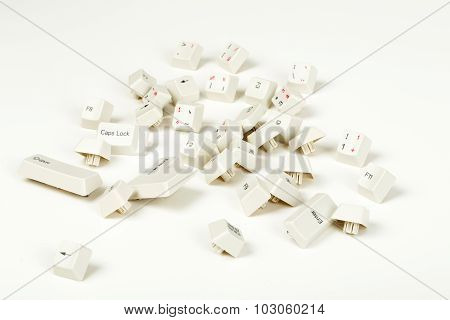 Scattered Keyboard Keys On White