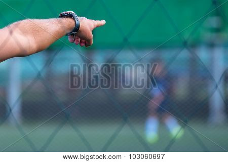 Kids Soccer Coach On Football Pitch