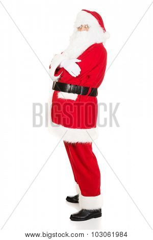Confident old man in Santa costume with arms crossed