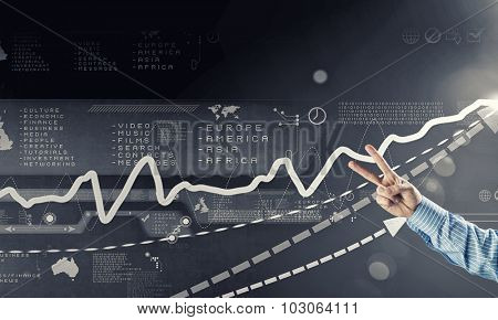 Hand holding cutting with fingers rising arrow representing business growth