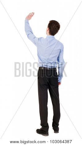 Back view of beautiful business man welcomes.  Young businessman in suit. Rear view  people collection.  backside view of person.  Isolated over white background. Businessman welcomed