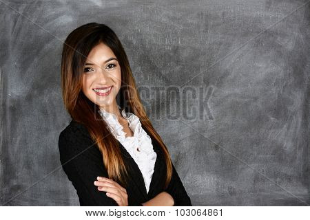 Teacher in her classroom ready to teach students