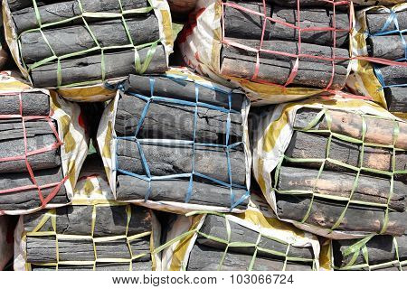 Wooden charcoal in sacks.