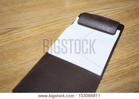Blank Bill receipt on table