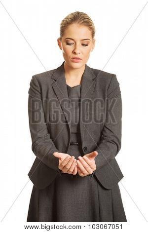 Woman with cupped hands for a product