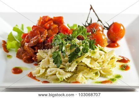 Farfalle with Tomato Sauce. Garnished with Cherry Tomato