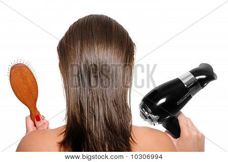 Young Woman With A Hair Dryer And Hairbrush
