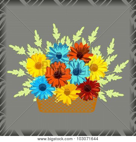 Basket with flowers. Gerberas and chamomiles on grey background.