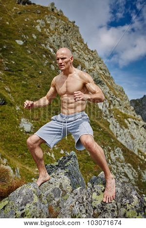 Kickboxer Or Muay Thai Fighter Training On A Mountain
