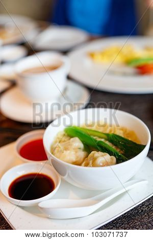 Delicious Chinese cuisine wonton dumplings served at restaurant