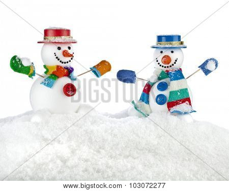 Two fun dancing snowmans in a striped scarfs, mittens and cylinder hat isolated on white background