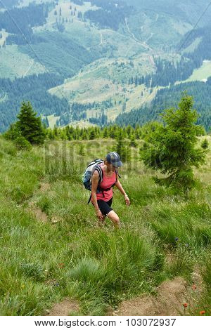 Woman Hiker On A Steep Trail