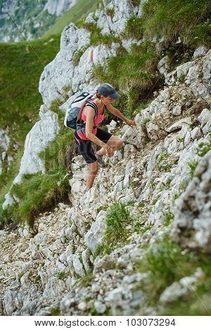 Hiker Woman On Steep Trail