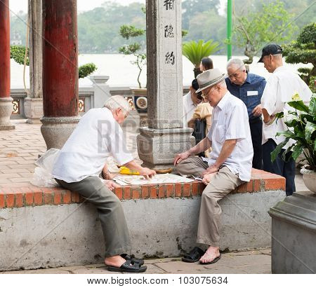Older people playing street chess