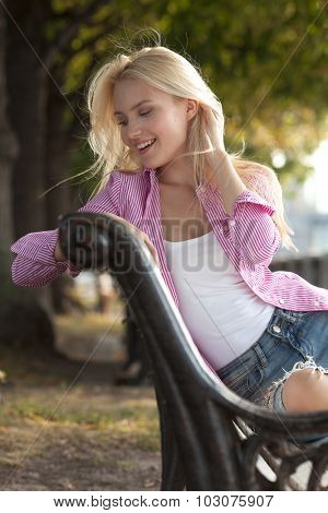 Beautiful young blond girl outdoors