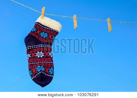 Odd Socks Hanging On A Clothesline On A Sky Background.