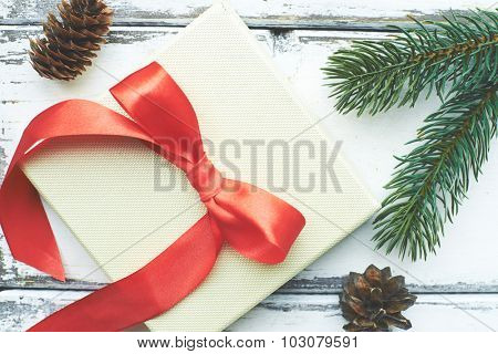 Composition made up of two cones, greeting card and coniferous branches
