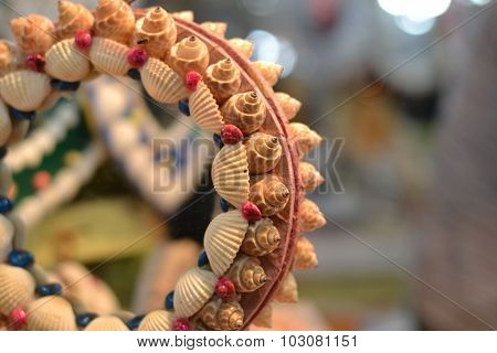 Small decorations with beach theme made from seashells and snail shells