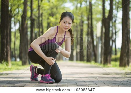 Asian Woman Runner Hold Knee Pain ,human Leg