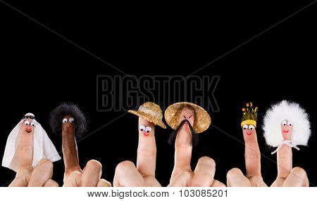 Human races and diversity symbolized with isolated finger puppets
