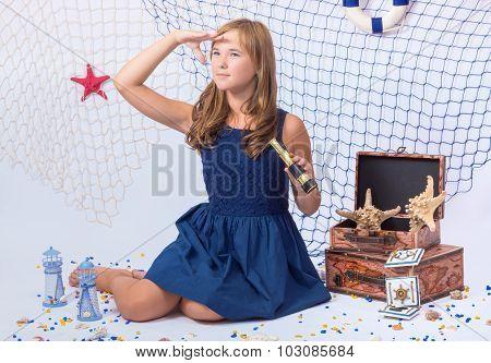 Beautiful teen girl looking afar with telescope in her hand