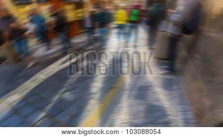 Blurred street which people