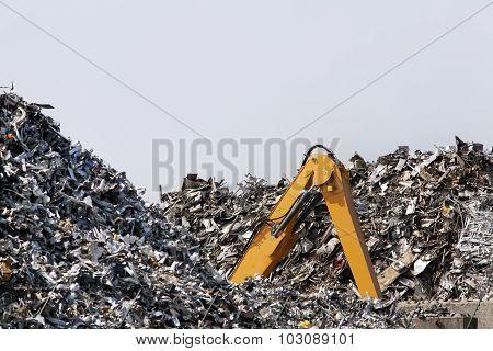 Crawler excavator lost in metal scrap