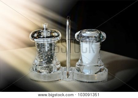 Salt And Pepper Mill In Restaurant Dining Table