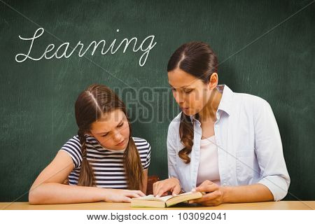 The word learning and teacher and girl reading book in library against green chalkboard
