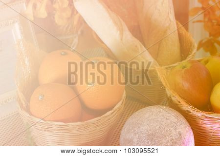 Apple, Orange And Bread In The Basket With Soft Focus And Color Filter