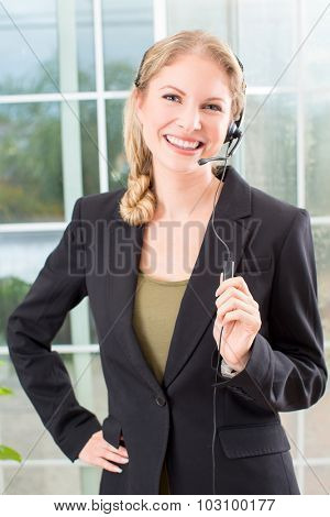 Business woman talking on a head set in her office