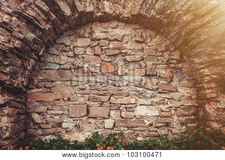 Ancient stone wall with arched niche